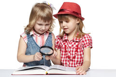 Two girls reading a book Stock Photo