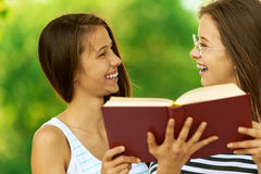Two girls reading book Stock Images