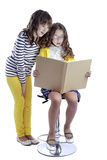Two girls reading book Stock Photos