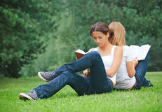 Two girls reading books Stock Photos