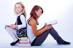 Two girls reading books Royalty Free Stock Photography