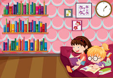 Two girls reading inside the house Stock Photography