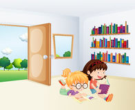 Two girls reading inside a room Stock Image
