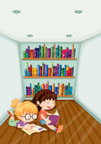Two girls reading inside the room Stock Images