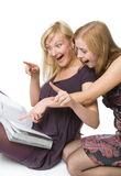 Two girls reading magazine Stock Photos