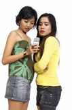 Two Girls Reading SMS Royalty Free Stock Images