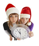 Two girls are ready to greet the new year. With a watch in his hand isolated on a white background stock images