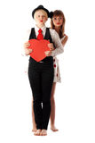 Two girls with red cardboard heart Royalty Free Stock Photos