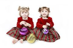 Two Girls in Red Dresses Royalty Free Stock Images