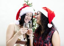 Two girls in red hat have fun Stock Photography