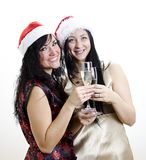Two girls in red hat have fun Royalty Free Stock Photography