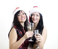 Two girls in red hats have fun Stock Photo