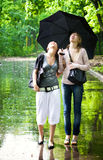 Two girls rejoice to rainy weather.  stock photos