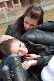 Two girls relax in a park Royalty Free Stock Photo