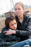Two girls relax in a park Stock Image