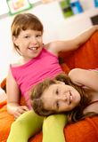 Two girls relaxing at home Royalty Free Stock Image