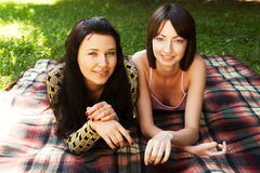Two girls relaxing in park Royalty Free Stock Photography