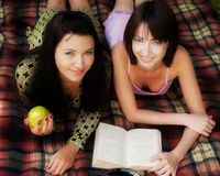 Two girls relaxing in park Royalty Free Stock Photos