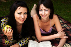 Two girls relaxing in park Stock Photo