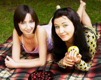 Two girls relaxing in park Royalty Free Stock Photo