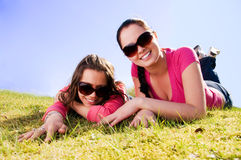Two girls relaxing in a park Stock Photo