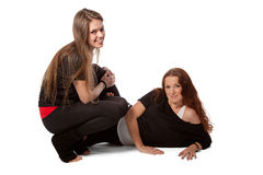 Two girls relaxing in a yoga Stock Image