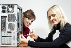 Two girls repairing computer Stock Photos