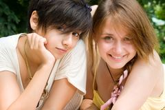 Two girls rest on fresh air outdoors Stock Photos