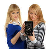Two girls with retro photographic camera. royalty free stock photography