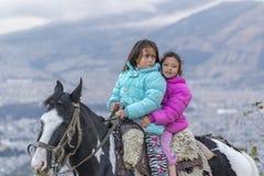 Two Girls Riding a Horse Quito Ecuador Stock Image