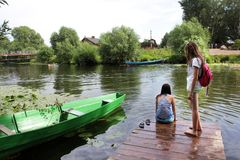 Two girls on the river mooring royalty free stock image