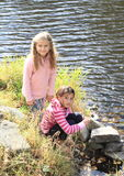 Two girls by the river Stock Photography