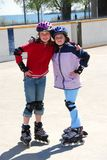 Two girls rollerblading Royalty Free Stock Images