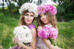 Two girls with rose peony wreath Stock Photo