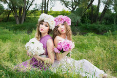 Two girls with rose peony wreath Royalty Free Stock Image