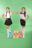 Two girls on rug with numbers Stock Image