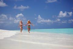 Tropical girls run Stock Image
