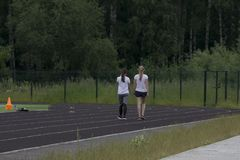 Two girls run along the paths.  Royalty Free Stock Photos