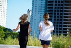 Two girls running Stock Photo