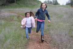 Two Girls Running Stock Images