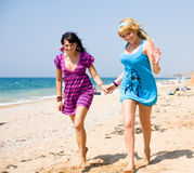 Two girls running on background of the sea Royalty Free Stock Photography