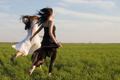 Two girls running on the field 3 royalty free stock image