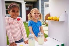 Two Girls Running Homemade Lemonade Stand Royalty Free Stock Images