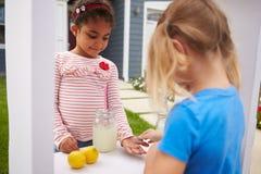 Two Girls Running Homemade Lemonade Stand Stock Photography