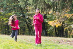 Two girls running Royalty Free Stock Photography