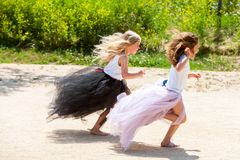 Two girls running together in park. Royalty Free Stock Photos