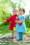 Two  girls  in sandbox Stock Photography