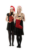 Two girls in the Santa hat Stock Photos