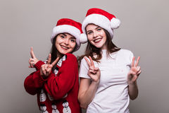 Two girls in Santa hat Stock Photography