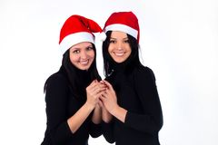 Two girls in the Santa hat with a laugh Stock Photo